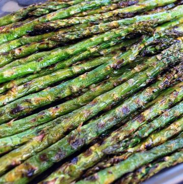 close up of grilled asparagus on a platter