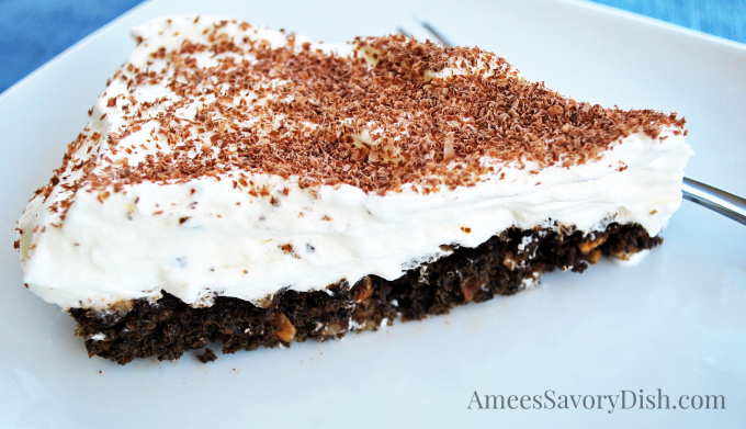 An easy baked chocolate pie recipe made with chocolate wafer cookies, hazelnuts, egg whites and whipped topping.