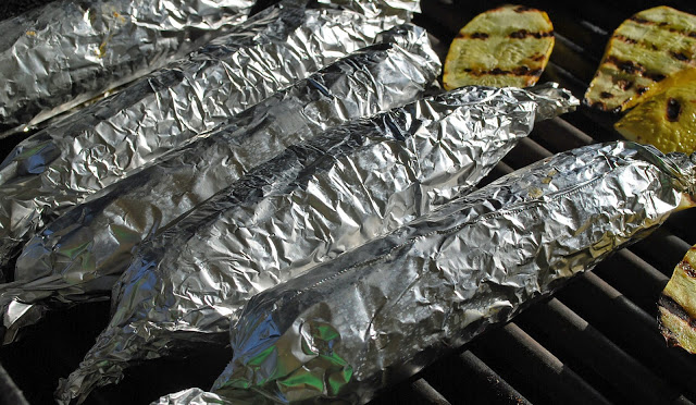 corn on the cob, wrapped in aluminum foil - grilled corn on the cob