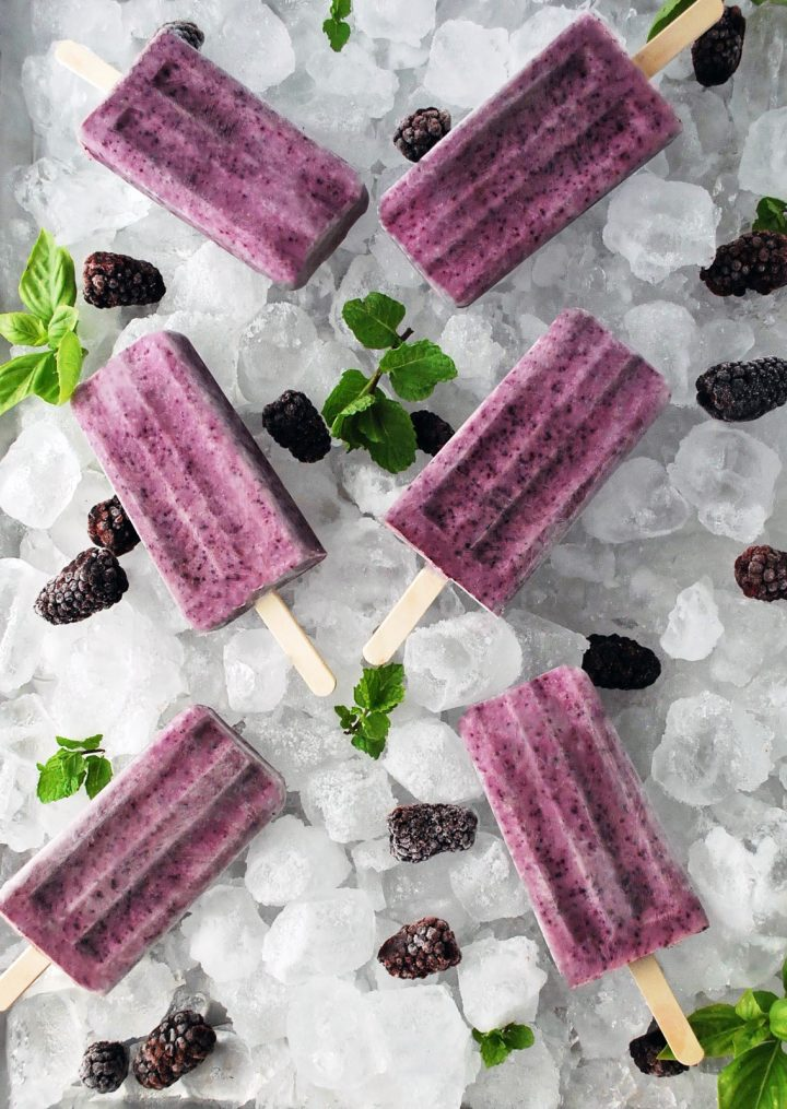platter of ice and greek yogurt pops with berries and herbs