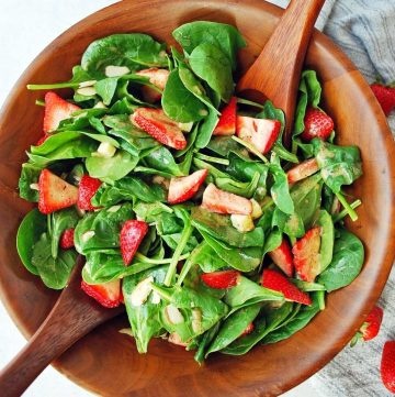 close up of a bowl of strawberry spinach salad