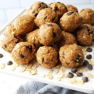side view of bliss balls with chocolate chips and oats on a platter