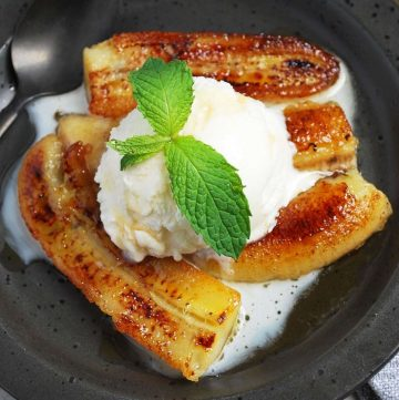 plate of caramelized bananas with ice cream and fresh mint