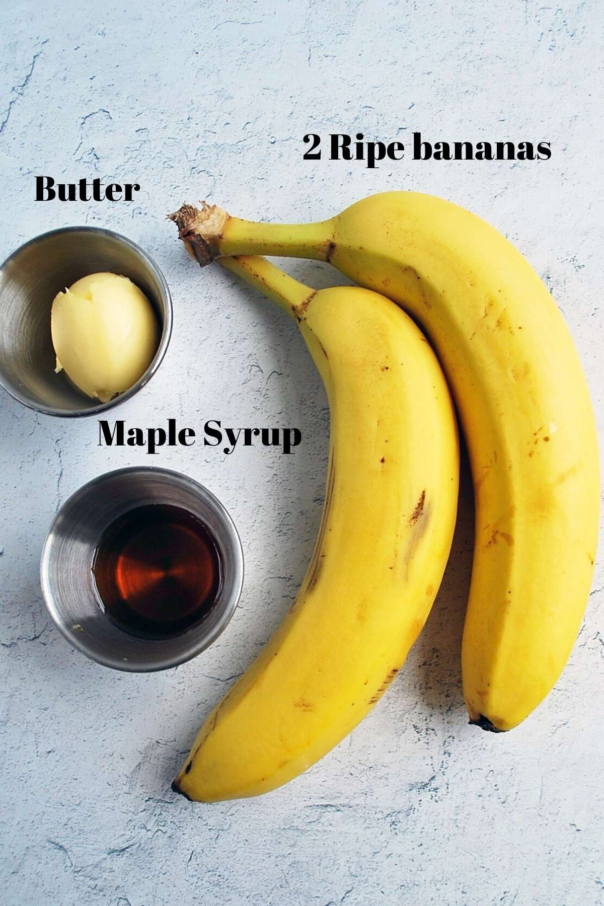 ingredients for caramelized bananas: banana, maple syrup, and butter