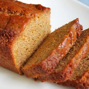 close up of a loaf of zucchini bread sliced on a plate