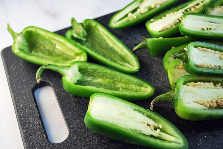 jalapenos sliced with the seeds and membrane scooped out