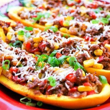 stuffed squash boats topped with cheese and chopped green onions