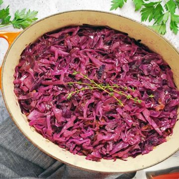 pot of braised red cabbage with fresh thyme on top