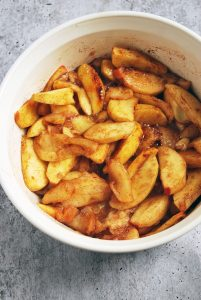 cooked apples in a baking dish