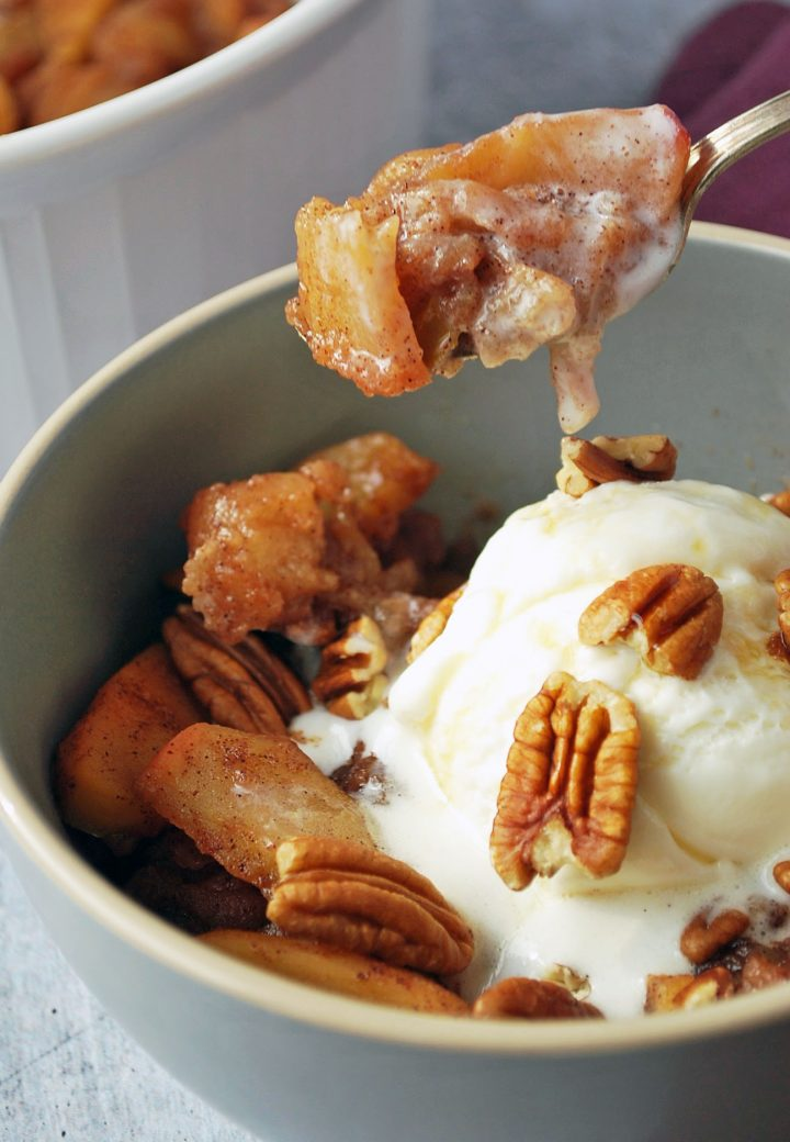 spoonful of baked apples with ice cream