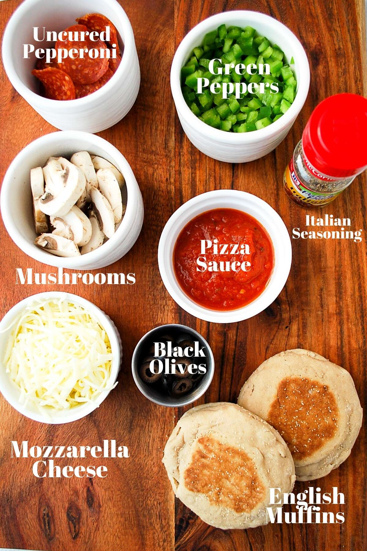 English muffin pizza ingredients on a cutting board