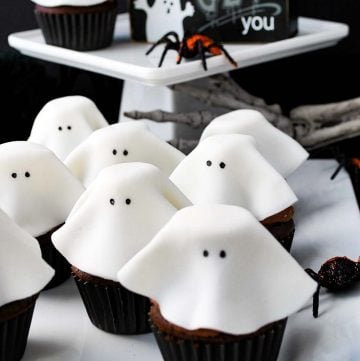floating ghost cupcakes for Halloween on a tray