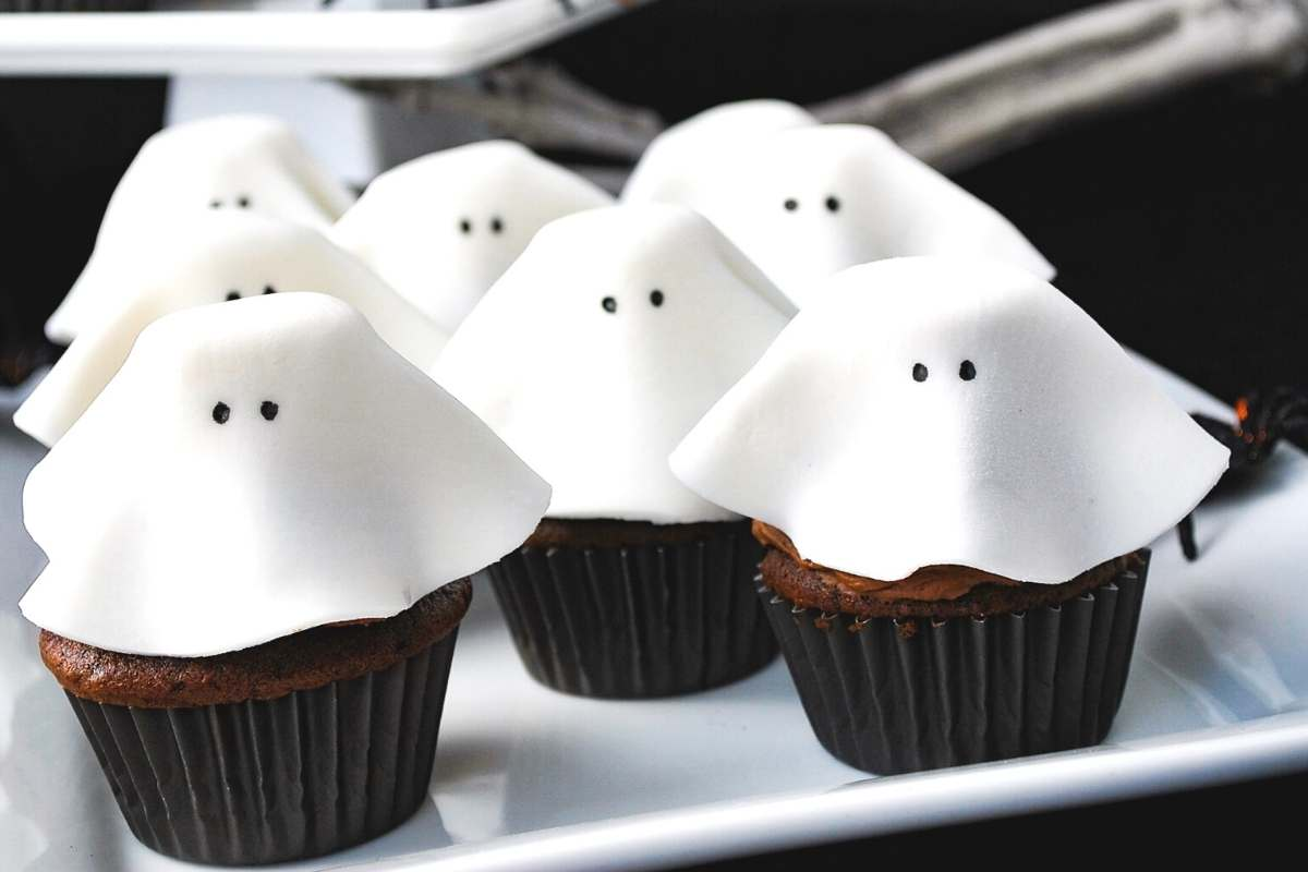 close up of fondant ghost cupcakes on a platter