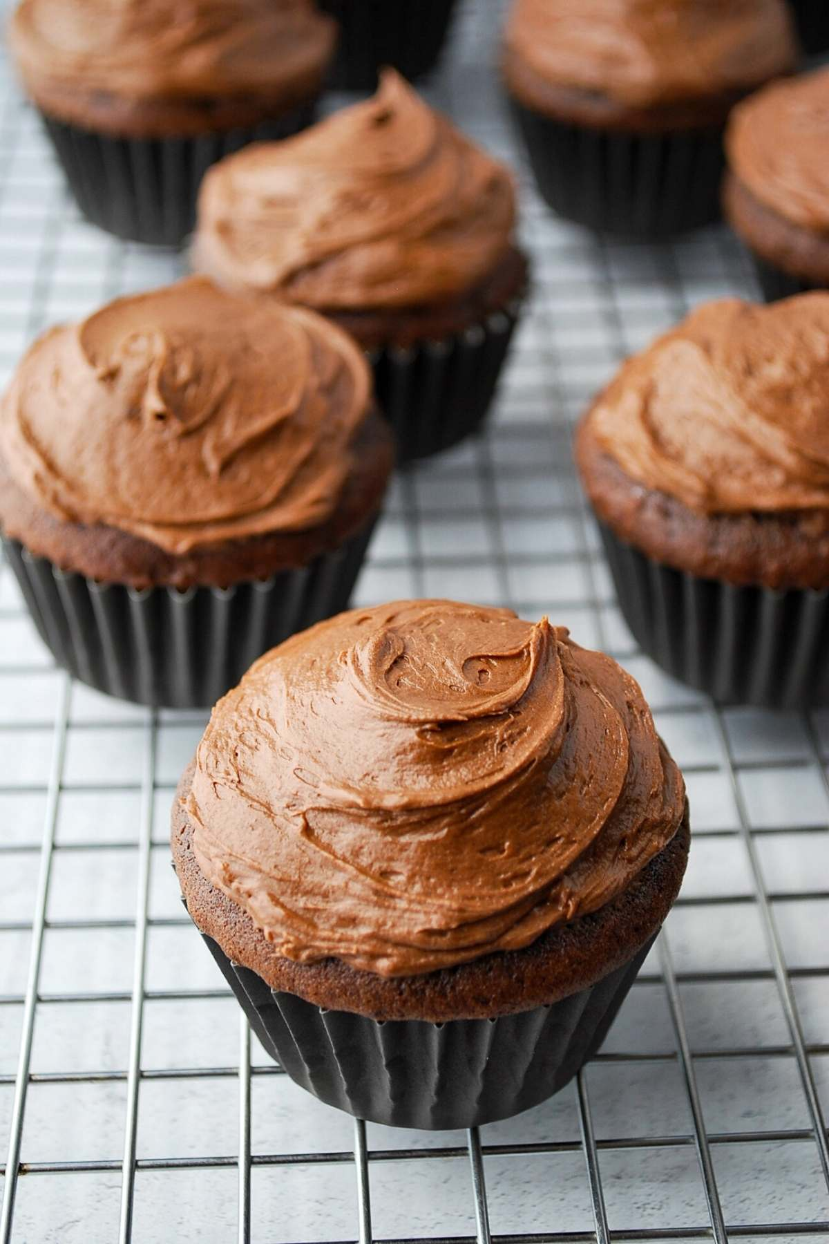 frosted chocolate cupcakes on a rack