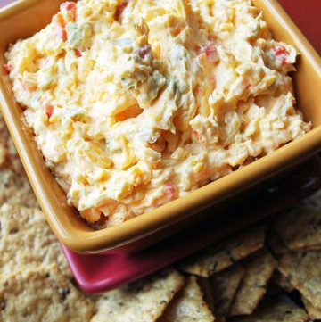 bowl of spicy pimento cheese with crackers