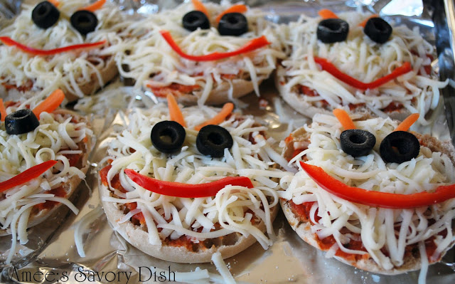 monster face pizzas on a baking sheet