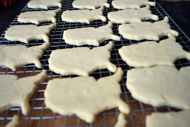 United States shaped sugar cookies on a wire rack