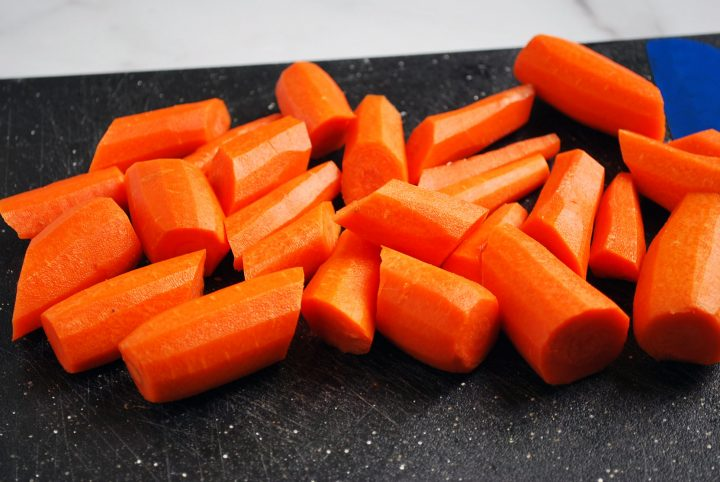 thick cut carrots on black cutting board