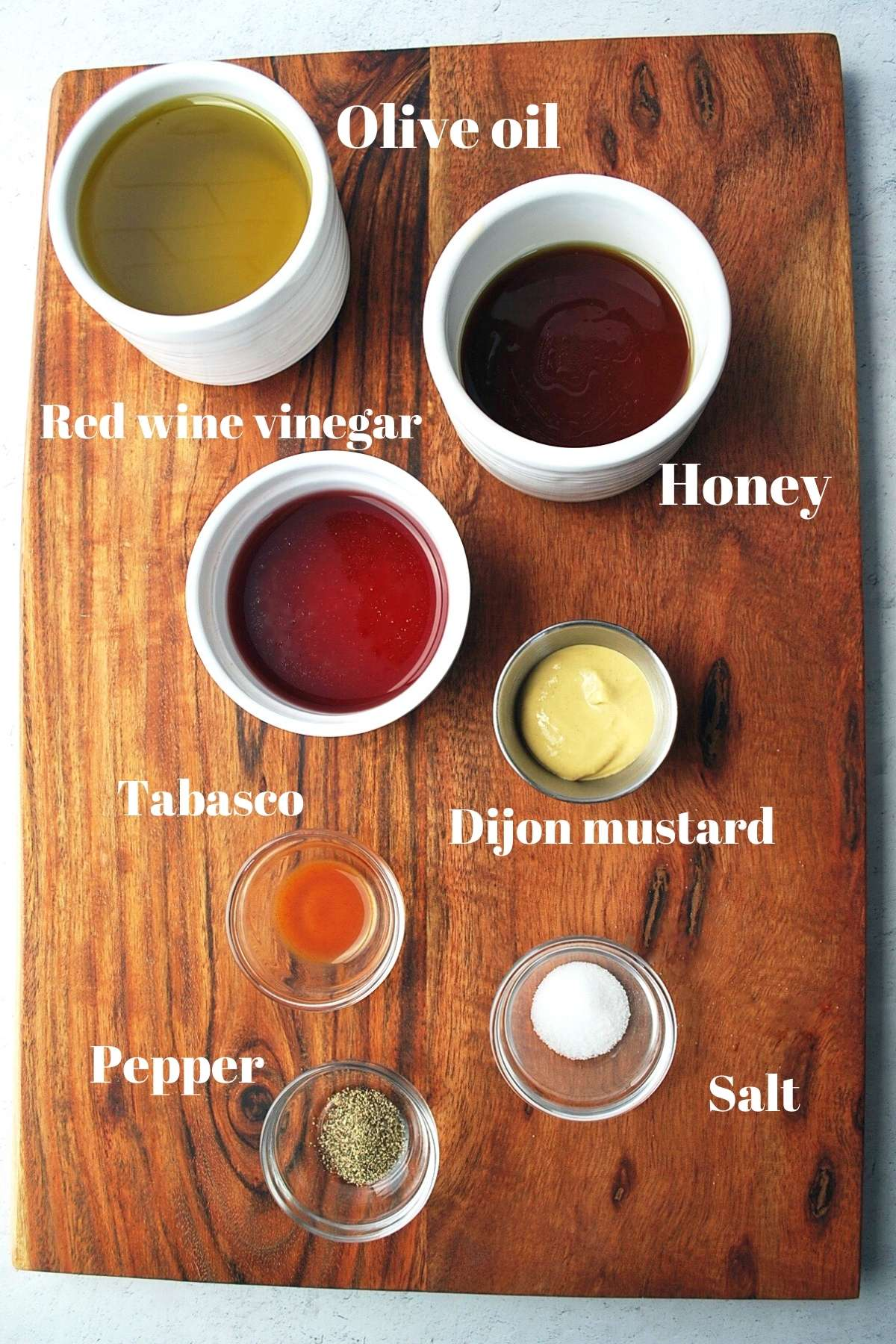 ingredients for honey mustard vinaigrette on a cutting board
