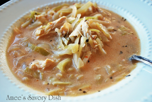 Coconut curry chicken soup is so full of flavor, it will rock your taste buds!!  This crockpot recipe makes a spicy soup for a comforting winter time meal.