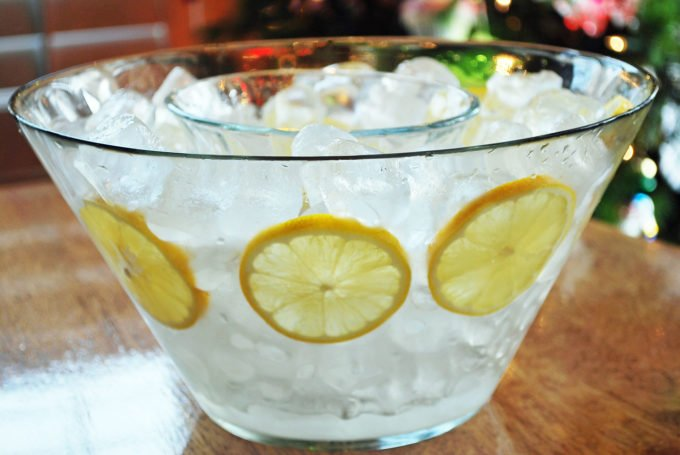 clear bowl full of ice and lemons for serving shrimp cocktail