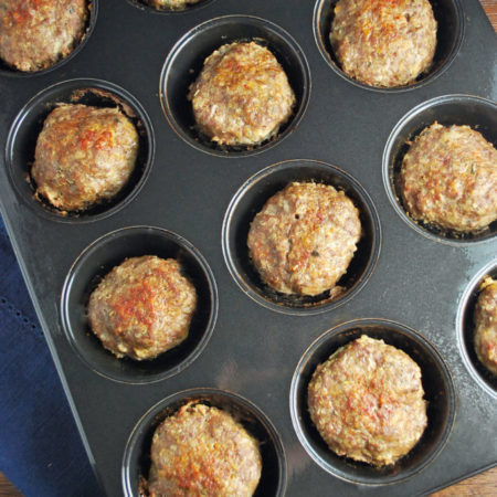 mini beef quinoa meatloaves in a muffin tin
