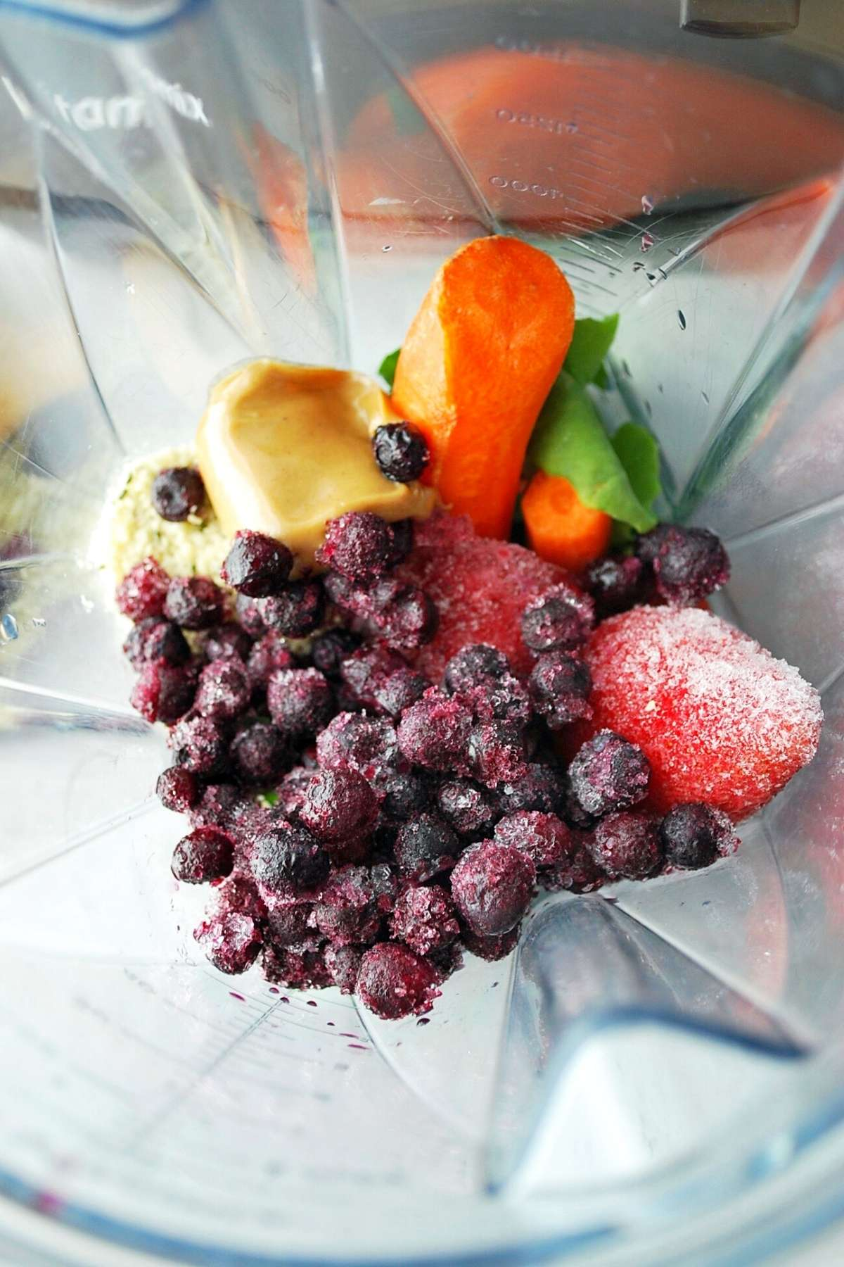 smoothie ingredients in a blender container
