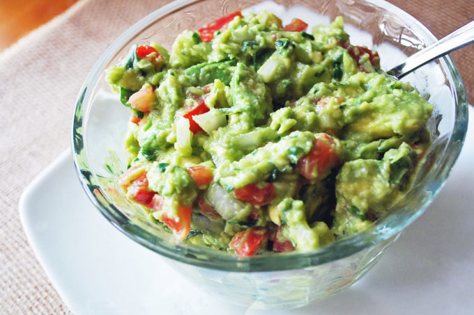 Awesome guacamole is homemade guacamole, made from ripe avocados, tomatoes, onion, fresh cilantro lime juice... and a secret ingredient that makes the perfect guacamole seasoning!