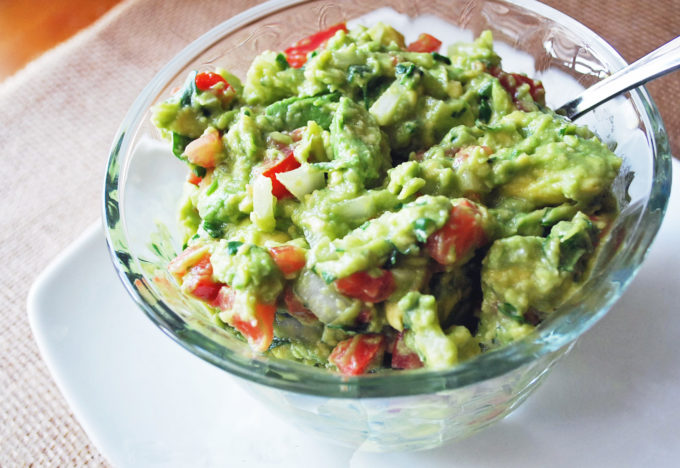 Guacamole in a clear glass bowl