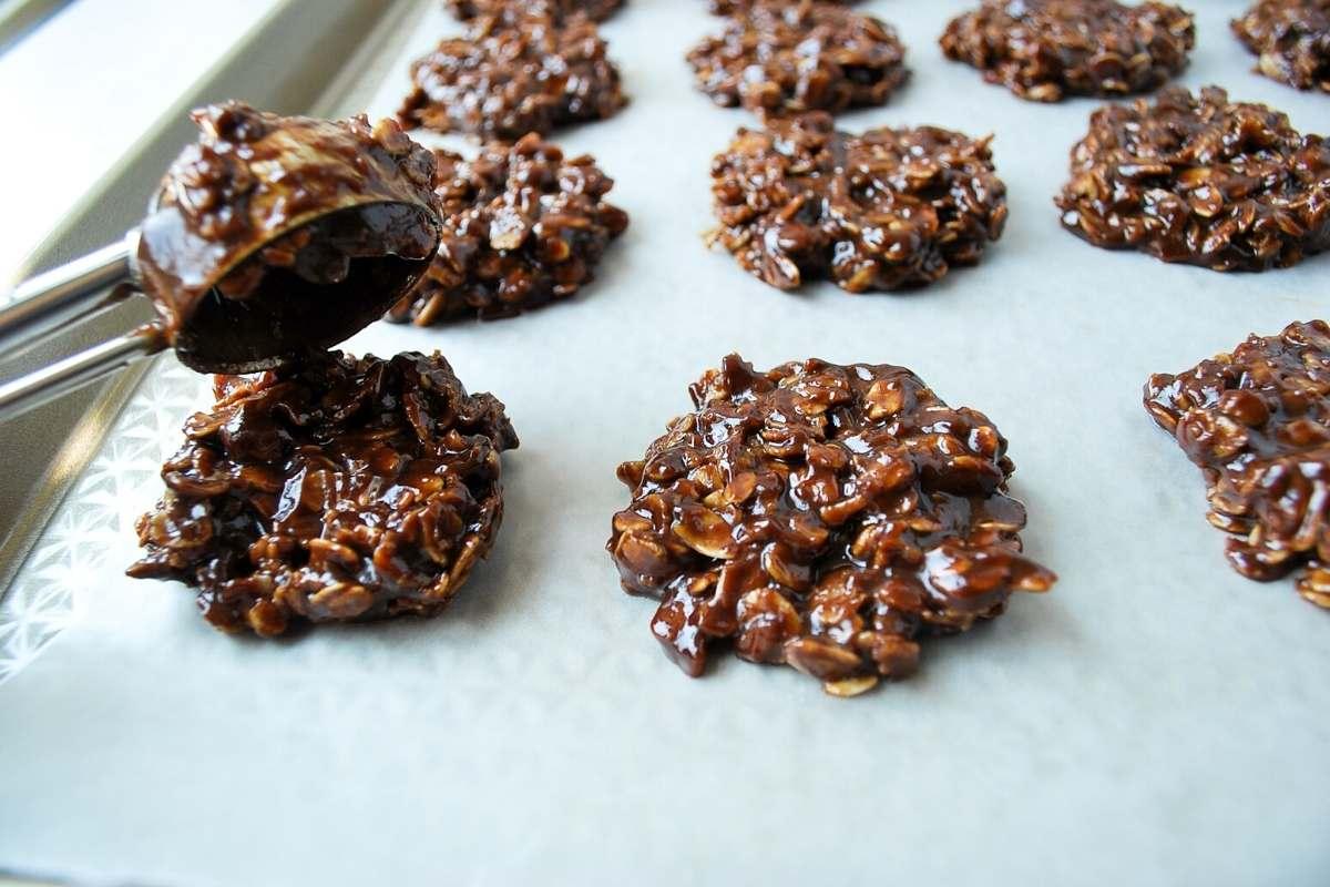dropping no-bake cookies onto a wax-lined baking sheet