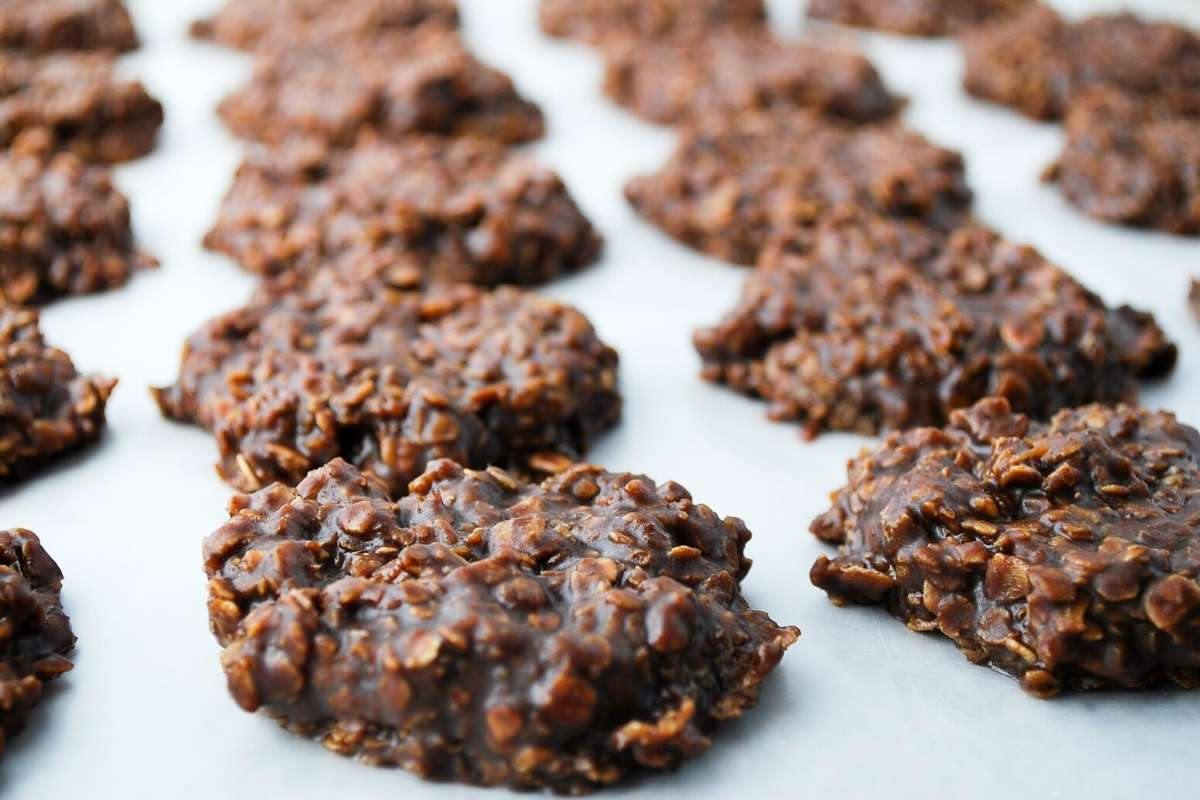 chilled no-bake cookies on a lined baking sheet
