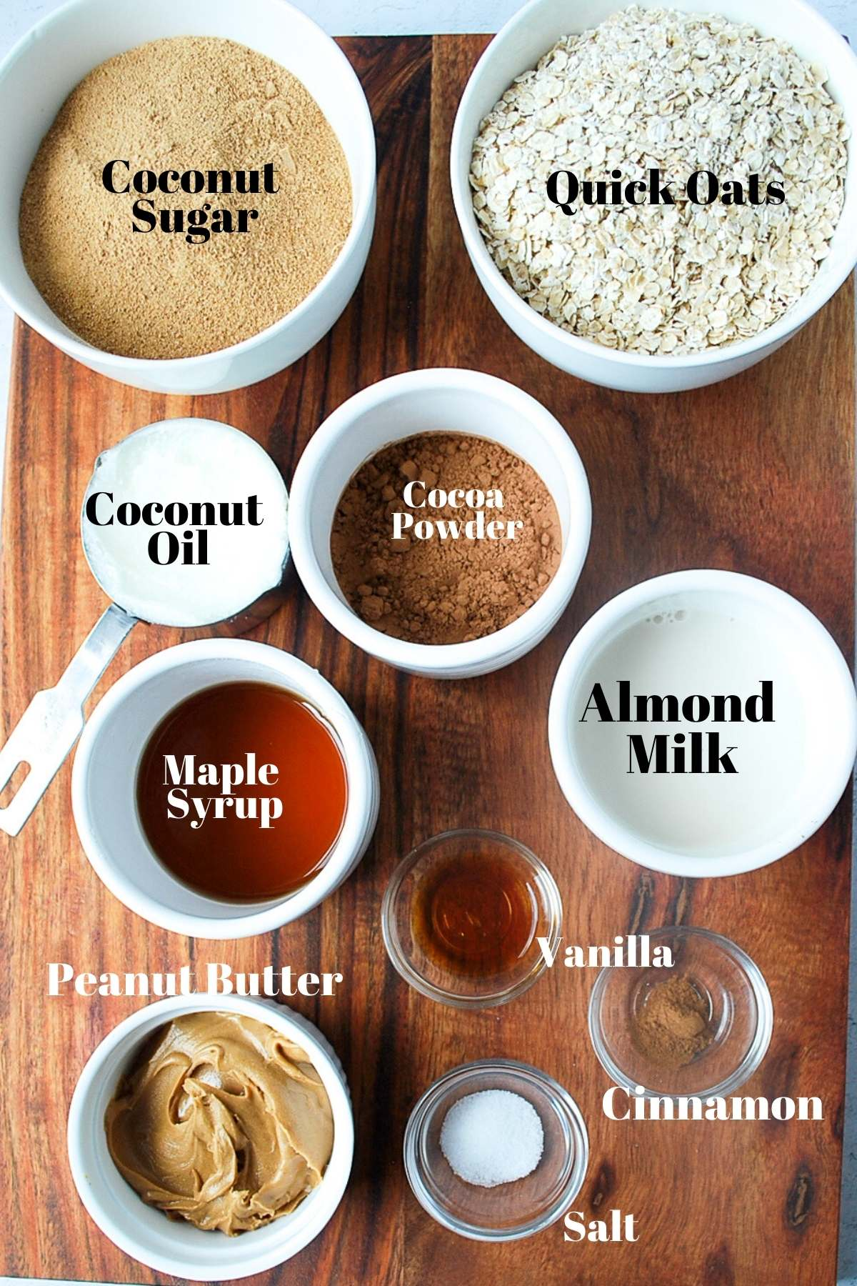 coconut sugar, oats, coconut oil, cocoa powder, almond milk, maple syrup, peanut butter, vanilla, salt and cinnamon on display for no-bake cookies