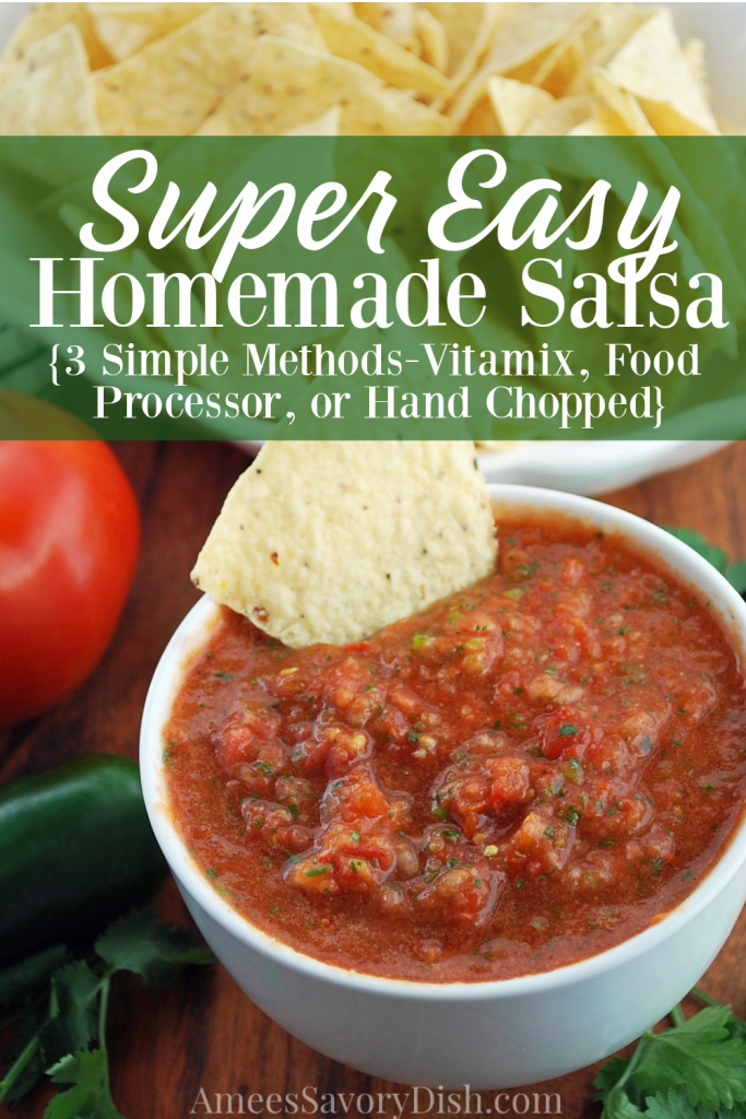 homemade salsa in a bowl with a dipped chip