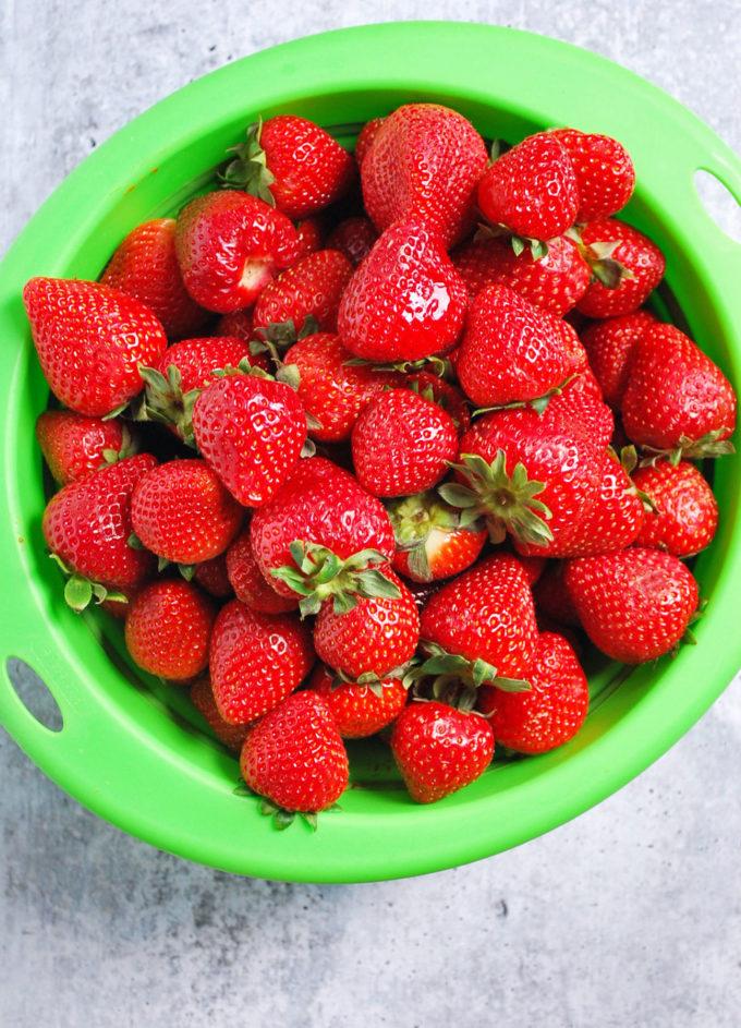 Fresh strawberries in colander for fresh strawberry pie