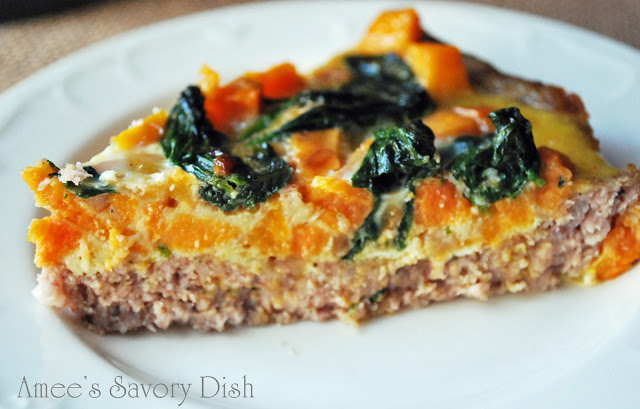 Meat crust quiche is a paleo quiche recipe. The crust is made using pork breakfast sausage and the meat crust is filled with a sweet potato and spinach mixture.
