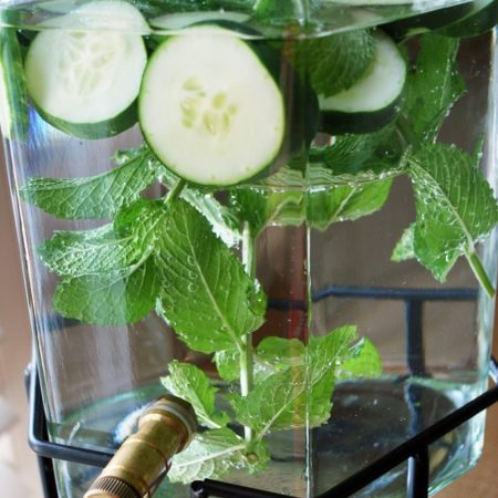 cucumber mint water in a serving jug