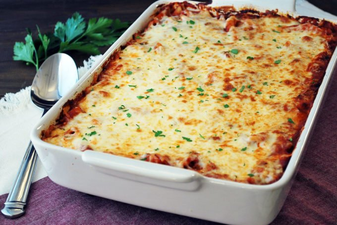 Pan of freshly baked mostaccioli casserole with spoon