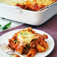 baked mostaccioli on a plate and in a baking dish