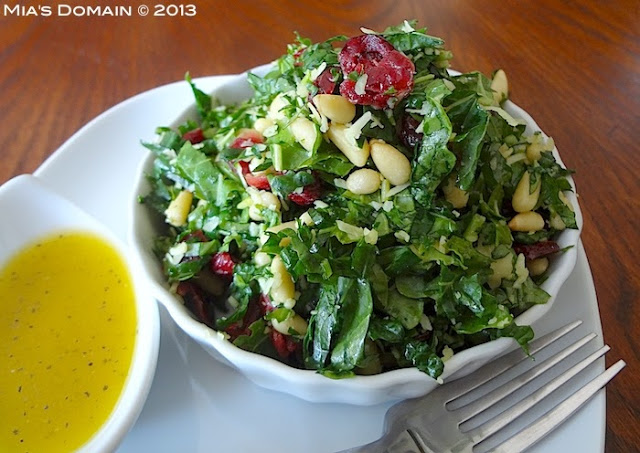 Kale salad, tossed with cranberries, pine nuts, and tangy lemon vinaigrette, is a delicious meatless salad recipe to fill you up with healthy goodness!