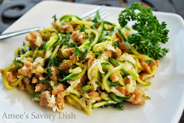 Zucchini pasta with sausage and Parmesan cheese