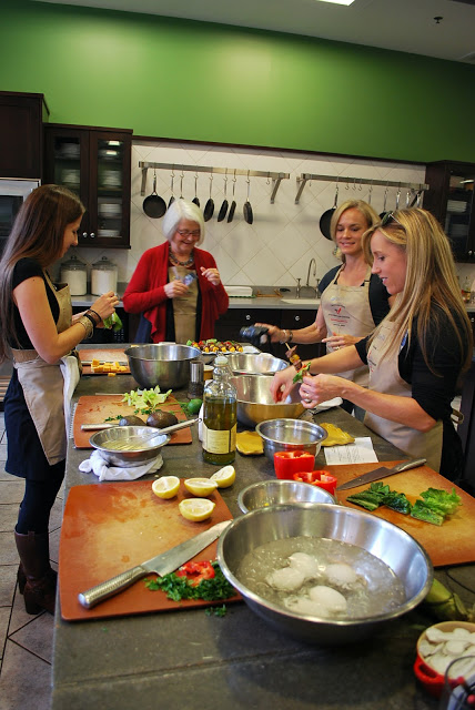 Food bloggers creating dishes at The Chopping Block