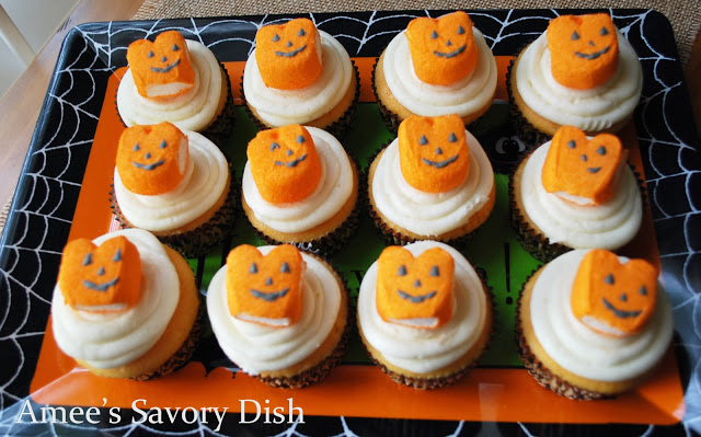 Homemade orange cupcakes, made from scratch, decorated in a fun Halloween theme.