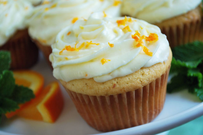 frosted orange cupcake with zest sprinkled on top