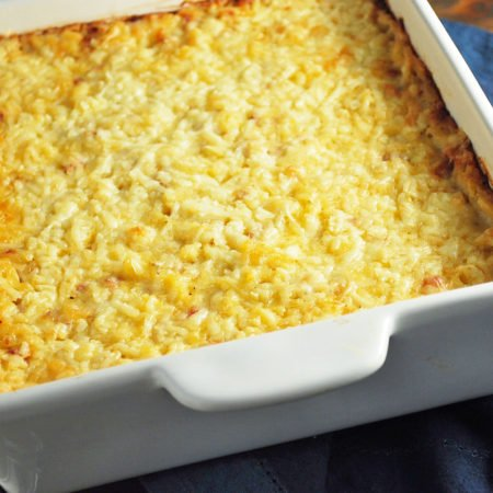 Pan of ham hashbrown casserole with a spoon