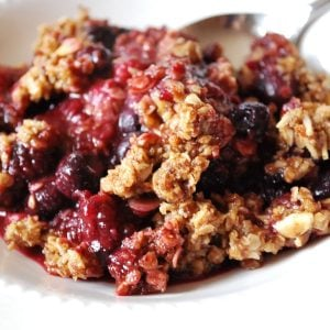 bowl of berry crumble with spoon