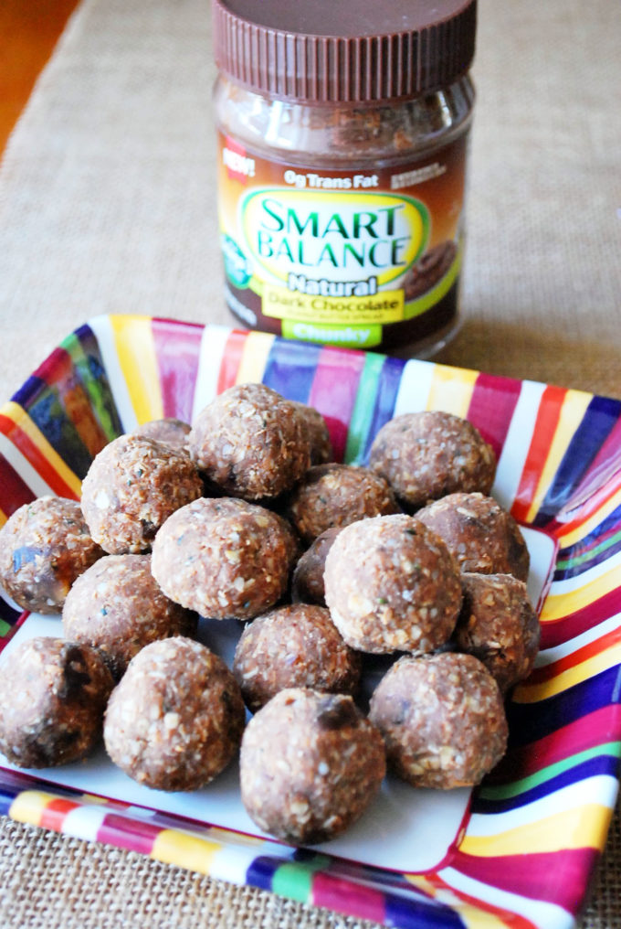 chocolate peanut butter protein balls and a jar of Smart Balance dark chocolate peanut butter
