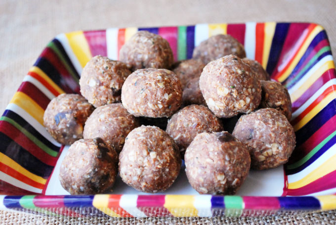 chocolate peanut butter protein balls in a colorful bowl