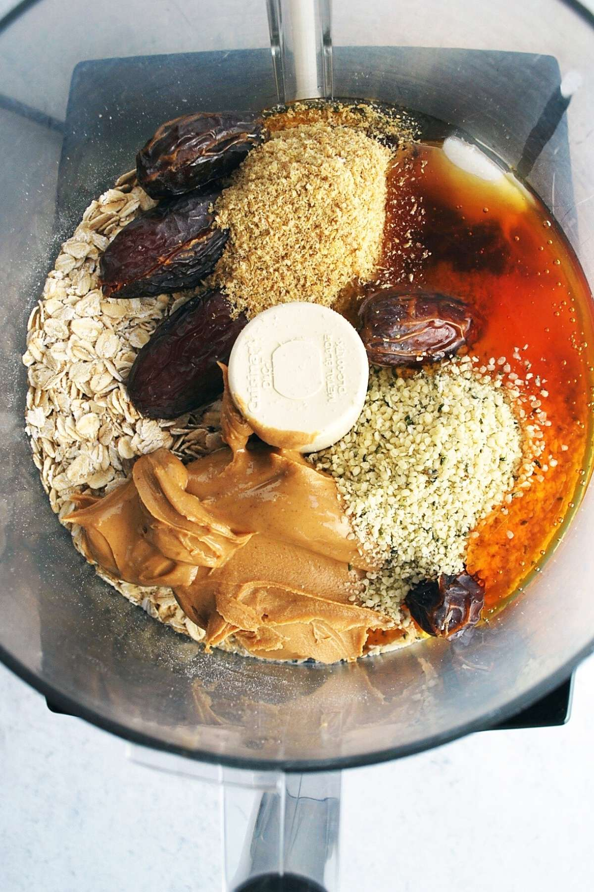 peanut butter protein ball ingredients in a food processor ready to blend