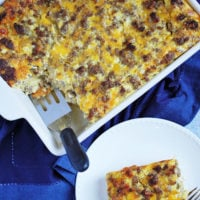 sausage and egg breakfast casserole in a dish and on a plate