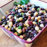 bowl of three bean salad with spoon